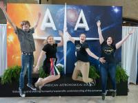 Attendees in front the AAS sign at AAS 234, St. Louis, Missouri.